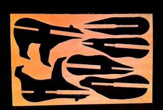 Wood outline of polar bear pieces.